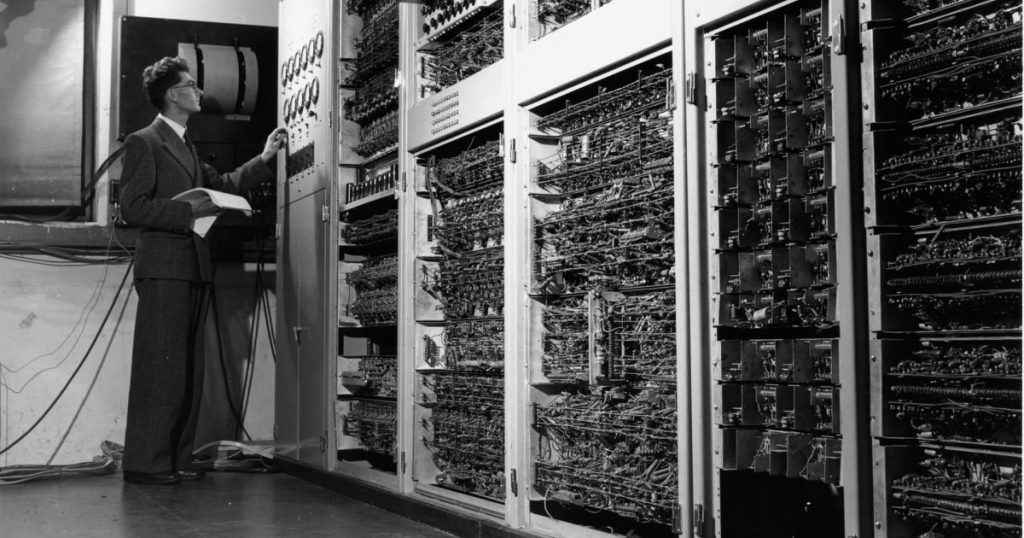 Man operating early computer