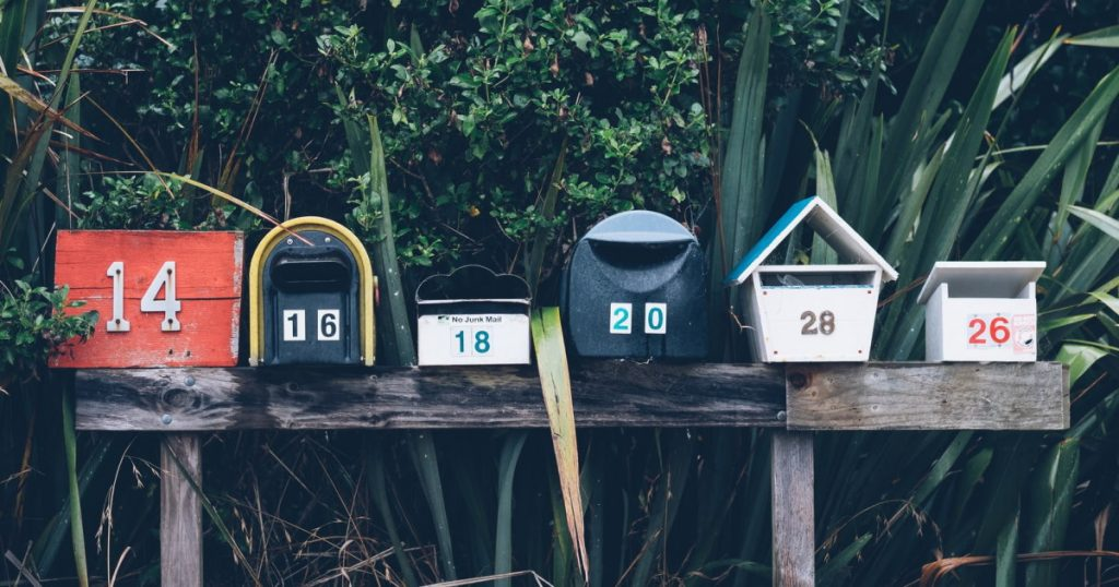 Six assorted color mail boxes
